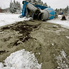 Record-Eagle/Keith King<br /> A cement truck lies on its side while cement oozes out after the truck went off a slippery Rapid City Road south of Rapid City Thursday. The driver of the truck sits nearby.