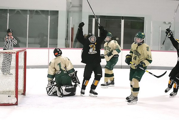 Record-Eagle/Keith King<br /> Traverse City Central's Caleb Morgan, middle, celebrates after completing a hat trick against Traverse City West on Saturday.