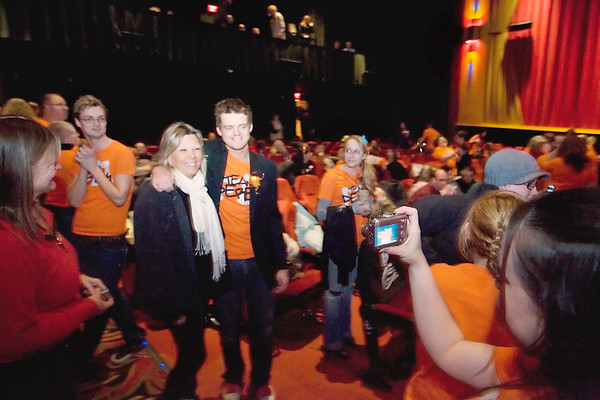 """Record-Eagle/Keith King<br /> Beverly Mills, of Traverse City, has her photo taken with Derek Woodruff Wednesday, at the State Theatre prior to the finale of """"The Arrangement,"""" on which Woodruff is a contestant."""
