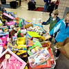 Record-Eagle/Keith King<br /> Sidra Smith, right, 8, and Jagger Smith, 6, both of Traverse City, make Toys for Tots donations at Fox Grand Traverse.