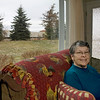 Record-Eagle/Keith King<br /> Berneice Gonder sits with her back to a window in her condo from which she can see the railroad cars, which haven't moved for months.