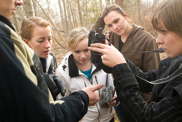 Record-Eagle/Jan-Michael Stump<br /> From left, Marek Ulicny explains a larval growth on a tree to Traverse City West Advanced Placement Biology students Natalie Wright, Karlene Kuhn, Mary Hoekje and Lexa Revnell. Ulicny and a group of current and graduated students want to create nature guides to local trails.