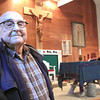 Record-Eagle/Nathan Payne<br /> <br /> Rev. Andrew Buvala stands in the Blessed Kateri Tekakwitha church north of Suttons Bay where he has served as a priest for more than 30 years. Buvala, 93, will retire tomorrow.