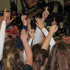 Record-Eagle/Dennis Chase<br /> TC St. Francis volleyball players celebrate their Class C district championship victory over McBain.