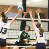 Record-Eagle/Keith King<br /> Traverse City West's Anna O'Hara (15) hits the ball as Grand Haven's Abby Cole (13), left, and Amy Kober (9), right, defend Tuesday, November 6, 2012 at Traverse City Central High School.