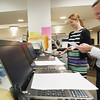 Record-Eagle/Keith King<br /> Benjamin Marentette, right, city clerk, and Katie Lowran, deputy city clerk, load and update election polling book information, which includes lists of voters and of those who received absentee ballots, on laptop computers Monday, November 5, 2012 at the Governmental Center in Traverse City so that the computers would be ready to be utilized by precincts on election day.