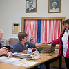 Record-Eagle/Jan-Michael Stump<br /> Jessica Paquette, right, receives her ballot from election workers, from left, Jim Hutchison, Jan Kiessel and Earlene Hill  Tuesday in Leelanau County's Bingham Township Hall Tuesday. Paquette was the 500th voter through the door Tuesday of the precinct's 2,148 voters, while approximately 600 cast absentee ballots.