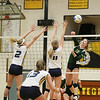 Record-Eagle/Keith King<br /> Traverse City West's Courtney VanHouzen hits the ball against Grand Haven Tuesday, November 6, 2012 at Traverse City Central High School.