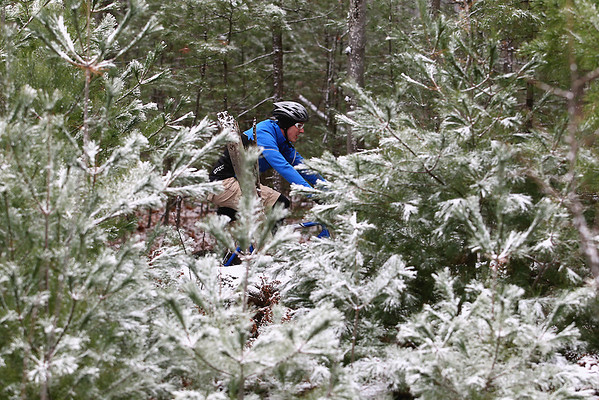 Record-Eagle/Jan-Michael Stump<br /> Racers make their way down the trail near Broomhead Road under freshly fallen snow in Saturday's 23rd annual Iceman Cometh Challenge.