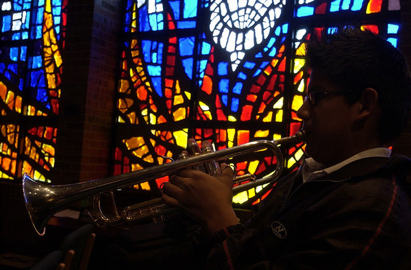 Record-Eagle/Garret Leiva<br /> Interlochen Arts Academy first-year trumpet major Elmer Churamti, 14, of Lima, Peru, rehearses at St. Francis Catholic Church.