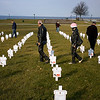 Record-Eagle/Keith King<br /> People walk among crosses at the Open Space Thursday, November 11, 2010 that have photos and names of Michigan military members who've been killed in Afghanistan and Iraq attached to them.