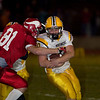 Record-Eagle/Jan-Michael Stump<br /> Suttons Bay's Craig Send brings down Iron Mountain's Josh Pender.