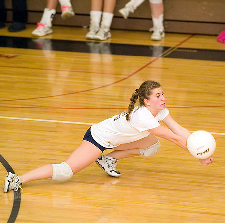 Record-Eagle/Jan-Michael Stump<br /> Traverse City St. Francis' Danielle Bott (2) dives for a dig against Pine River in Tuesday's regional game at Glen Lake.