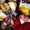 Record-Eagle/Jan-Michael Stump<br /> Iron Mountain's Nate Secinaro (8) tackles Suttons Bay's Aiden Keilty (20), and draws a face mask penalty, in Friday's Division 6 regional final.