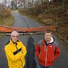 Record-Eagle/Keith King<br /> Ken Crowhurst, left, and Jason Bigg, both of Acme Township, stand near an obstructed road that goes in and out of the neighborhood where their houses are located.