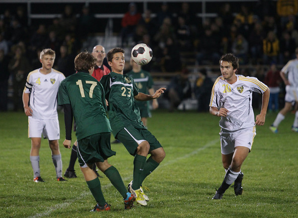 Record-Eagle/Keith King<br /> Traverse City West's Cameron Sipple (23), tries to control the ball near Traverse City Central's Reilly deTar (20) Wednesday, October 16, 2013 in Traverse City.