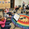 Record-Eagle/Keith King<br /> Jennifer McAndrew, back right, Crooked Tree Arts Center music education assistant director, conducts a beginner strings class at Charlevoix Elementary School Wednesday, October 9, 2013 as part of the Gerber Strings Program.