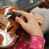 Record-Eagle/Keith King<br /> A student holds a violin during a beginner strings class at Charlevoix Elementary School Wednesday, October 9, 2013 as part of the Gerber Strings Program.