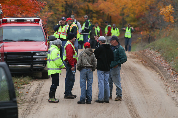 Record-Eagle/Keith King<br /> Members of a search party gather on Pioneer Road in Homestead Township Wednesday, October 16, 2013 to look for Loyal Frederick, 83, of Homestead Township, after Frederick went missing Tuesday. Frederick was spotted at about 1:00 p.m. near Pioneer Road and Fewins Road in Homestead Township.