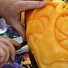 Record-Eagle/Allison Batdorff<br /> Top, Pat Harrison carves about 400 pumpkins a season.