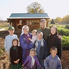 Record-Eagle/Keith King<br /> The Schaaf family stand near their store and portion of their garden, or  miniature farm, Wednesday, October 17, 2012 in Bear Lake Township. In the front row are Anna, from left, 9, Naomi, 4 and Josiah, 6. In the back row are Jacob, from left, 14, Kyra, holding her daughter, Mary, 16 months, Moriah, 12, Craig and his daughter Sarah, 13.