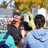 Record-Eagle/Dan Nielsen<br /> Denny Hoxsie tells a group about different types of gourds at Hoxsie's Farm Market near Williamsburg.