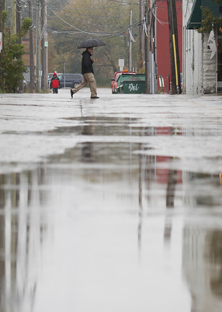 "Record-Eagle/Keith King<br /> Mike Fitzpatrick, of Traverse City, walks along Union Street in rainy conditions Thursday, October 31, 2013 in downtown Traverse City. The Traverse City area could see an inch or more of additional rainfall tonight into Friday morning, a meteorologist said. Mike Boguth of the National Weather Service in Gaylord said up to 1.25 inches of additional rain could fall by this morning. ""The heaviest rain is yet to come,"" Boguth said. ""Some really steady, soaking rains. There is definitely a chance of a rumble of thunder."" A gale wind warning is also in place for Lake Michigan and Lake Huron."