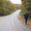 Record-Eagle/Glenn Puit<br /> Walter Hoegy starts to walk up a hill in Empire Township in the face of chilly fall temperatures.