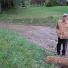Record-Eagle/Michael Walton<br /> Alan Gray, of Peninsula Township, stands in a retention basin on his property that he said no longer drains properly due to water runoff and soil erosion from a nearby construction project.