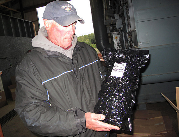 Record-Eagle/Glenn Puit<br /> Dan Wiesen holds a bag of hops produced at the Empire Orchards Hops Farm. Wiesen owns the farm with his brother Mike. The men have decided to expand their hops-growing operation significantly because of strong demand from breweries.
