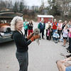 "Record-Eagle/Keith King<br /> Rebecca Lessard, executive director of Wings of Wonder, shows a male barred owl to spectators prior to releasing him into the wild Thursday, October 25, 2012 behind the Leelanau Montessori Public School Academy in Suttons Bay. The owl was in rehabilitation at Wings of Wonder for about four weeks after he was hit by a car near Suttons Bay High School. ""I told him last night, ' This is your last free meal. You're going to have to get out of the resort and go hunt.' ,"" Lessard said."