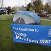 Record-Eagle/Keith King<br /> <br /> A sign for the Coalition to Keep Michigan Warm is displayed outside the Plante and Moran building Tuesday, October 25, 2011 during a sleep out with participants including local leaders, lead by Doug Luciani, president and CEO of the Traverse City Area Chamber of Commerce and aided by a grant from DTE Energy. Participants will sleep outside for the night to raise awareness of the needs that families in northern Michigan have for home heating assistance.