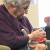 Record-Eagle/Jan-Michael Stump<br /> Annie Carroll holds Willow, the resident kitten on the third floor of Willow Cottage at the Grand Traverse Pavillions.