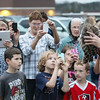 "Record-Eagle/Keith King<br /> Spectators admire and photograph a male barred owl held by Rebecca Lessard, executive director of Wings of Wonder, prior to the owl being released Thursday, October 25, 2012 behind the Leelanau Montessori Public School Academy in Suttons Bay.  The owl was in rehabilitation at Wings of Wonder for about four weeks after he was hit by a car near Suttons Bay High School. ""I told him last night, ' This is your last free meal. You're going to have to get out of the resort and go hunt.' ,"" Lessard said."