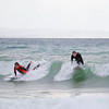 Record-Eagle/Keith King<br /> Spencer Crimmins, right, 16, of Leland, and August Bjoergul, 17, an exchange student from Norway, take advantage of the waves as they surf Thursday, October 25, 2012 in Lake Michigan at Leland's Van's Beach.