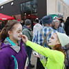 Record-Eagle/Keith King<br /> Olivia Cvengros, right, 12, of Traverse City, applies face paint to Caroline Peacock, 13, of Traverse City, as they prepare Saturday, October 27, 2012 for the start of the fourth annual Zombie Run 5k in Traverse City with proceeds from the run/walk going toward TART Trails.