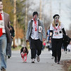 Record-Eagle/Keith King<br /> Kris and Brittney Filion, of Traverse City, walk their dog Coffee as they near the finish line Saturday, October 27, 2012 during the fourth annual Zombie Run 5k in Traverse City with proceeds from the run/walk going toward TART Trails.