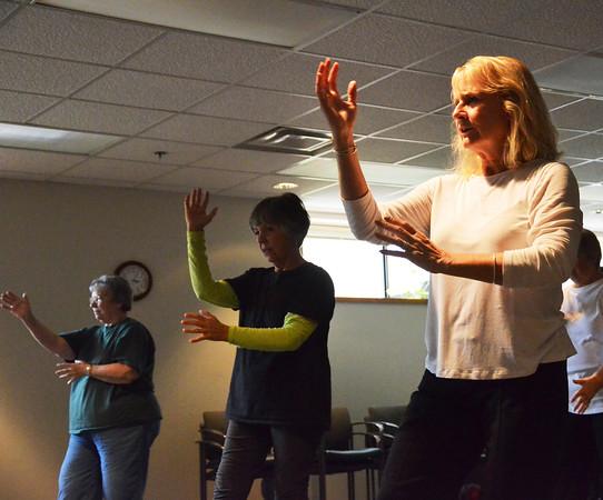 "Record-Eagle/Allison Batdorff<br /> From left, Charlotte Owen, Adelfa DaFoe and instructor Nancy Deye practice ""Tai Chi for Arthritis"" at the Munson Community Health Center."