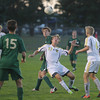Record-Eagle/Keith King<br /> Traverse City Central's Ethan Mason (17) and Traverse City West's Jack Lhamon (22) go for the ball Tuesday, October 8, 2013 in Traverse City.