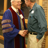 Record-Eagle/Loraine Anderson<br /> Rev. Gary Hogue greets church member Chuck Watling after Sunday's service at the First Congregational Church of Traverse City.