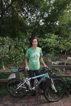Record-Eagle/Keith King<br /> Johanna Schmidt, of Traverse City, stands with her bike Thursday, October 3, 2013 at her home.