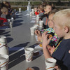 Record-Eagle/Keith King<br /> Traverse City Area Public Schools (TCAPS) Oak Park Preschool students, Trent Gle, from right, and Sophia Litzner, along with their classmates, enjoy pumpkin doughnuts and apple cider Wednesday, October 2, 2013 during a field trip at Gallagher's Farm Market.