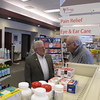 Record-Eagle/Glenn Puit<br /> Jim Bock, the former owner of the Prescription Shop pharmacies in northern Michigan, talks Thursday morning with longtime customer John Burgess. Bock is selling the stores to Michigan-based HomeTown Pharmacy, which wants to continue Bock's commitment to caring about locals.