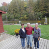 Record-Eagle/Keith King<br /> Sharon Pierce, left, and her sister Jennifer Coy, right, of Traverse City, stand with their father, Charlie Frye, Thursday, October 3, 2013 at his home in East Bay Township on the Boardman River.