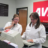 Record-Eagle/ Anne Stanton<br /> Avis sales agents Alyssa Irwin (left) and Kathie Bailey enjoyed a fairly calm day Monday after a weekend of helping desperate air travelers.