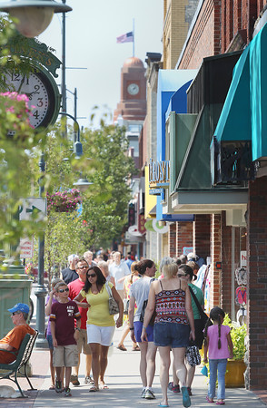 Record-Eagle/Keith King<br /> <br /> Pedestrians walk along Front Street Friday, August 31, 2012 in downtown Traverse City.