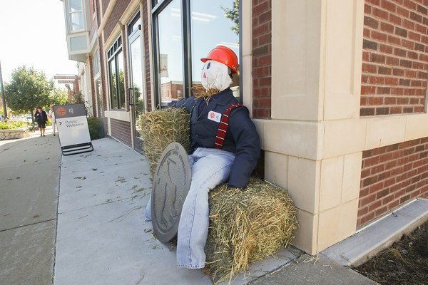 """Record-Eagle/Keith King<br /> A scarecrow is displayed Wednesday, October 9, 2013 in front of the EJ (East Jordan Iron Works) visitor center in downtown East Jordan for the """"Scarecrows Across the Breezeway"""" contest."""