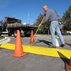 Record-Eagle/Michael Walton<br /> Paul Johnson, a grounds maintenance coordinator with Grand Traverse County, paints a speed bump outside the county's public works building Tuesday.