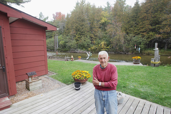 Record-Eagle/Keith King<br /> Charlie Frye, of East Bay Township, stands at his home Thursday, October 3, 2013 on the Boardman River.