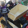 Record-Eagle/Keith King<br /> Coraline Rainey, a Traverse City Area Public Schools (TCAPS) Oak Park Preschool student, places an apple into a juice press as Rainey and her classmates watch apple cider being made Wednesday, October 2, 2013 during a field trip at Gallagher's Farm Market.